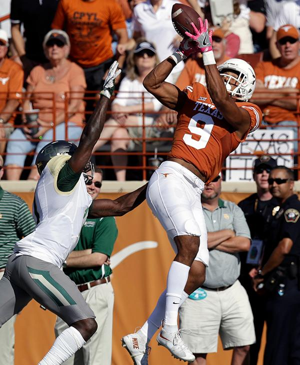 "<div class=""meta image-caption""><div class=""origin-logo origin-image ap""><span>AP</span></div><span class=""caption-text"">Texas wide receiver Collin Johnson (9) bobbles the ball and fails to catch a pass in front of Baylor linebacker Taylor Young (1) during the first half. (AP Photo/Eric Gay)</span></div>"