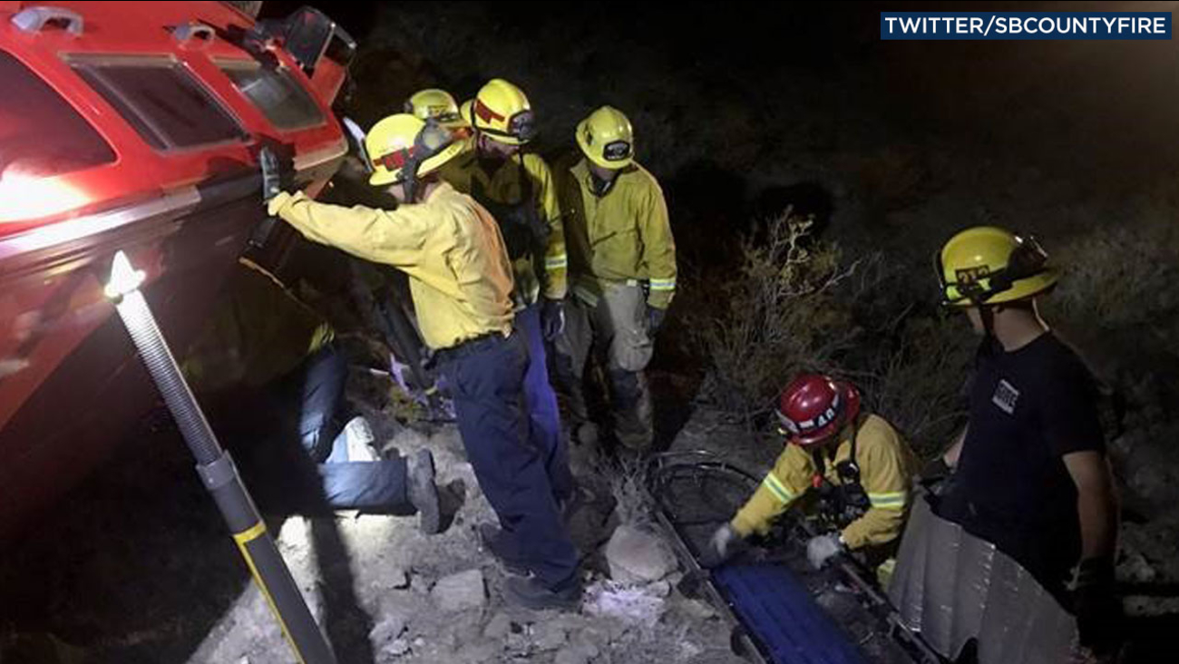Rescue crews worked to rescue a woman trapped inside an overturned vehicle in Adelanto on Saturday, Oct. 29, 2016.