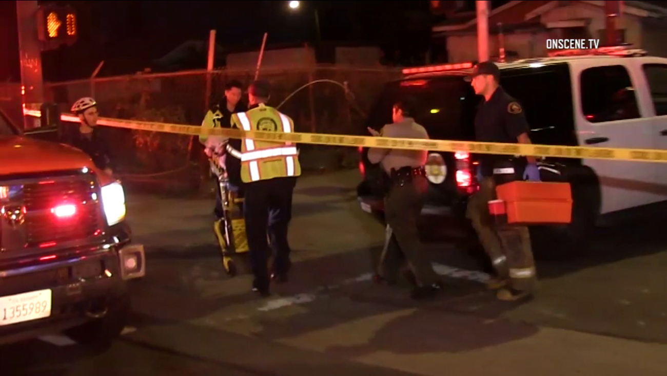 Sheriff's deputies and firefighter-paramedics responded to the Gramercy Park neighborhood of South L.A. after a shooting on Saturday, Oct. 29, 2016.