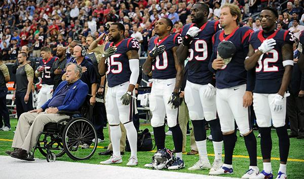 "<div class=""meta image-caption""><div class=""origin-logo origin-image ap""><span>AP</span></div><span class=""caption-text"">Former President George H.W. Bush, left, lines up with the Houston Texans for the national anthem as he helps celebrate Salute to Service day before an NFL football game. (AP Photo/Eric Christian Smith)</span></div>"