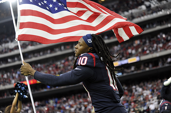 "<div class=""meta image-caption""><div class=""origin-logo origin-image ap""><span>AP</span></div><span class=""caption-text"">Houston Texans' DeAndre Hopkins (10) carries a flag to help celebrate Salute to Service day as he runs on to the field before an NFL football game. (AP Photo/Eric Christian Smith)</span></div>"