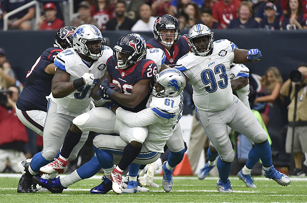 "<div class=""meta image-caption""><div class=""origin-logo origin-image ap""><span>AP</span></div><span class=""caption-text"">Houston Texans running back Lamar Miller (26) is stopped by Detroit Lions defensive end Kerry Hyder (61) and A'Shawn Robinson (91) during the first half of an NFL football game. (AP Photo/Eric Christian Smith)</span></div>"
