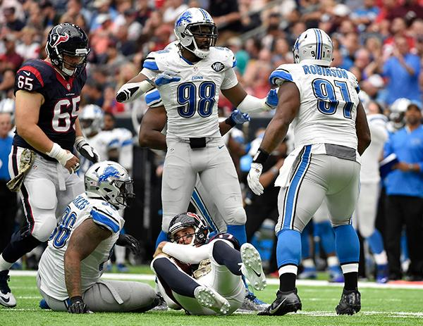 "<div class=""meta image-caption""><div class=""origin-logo origin-image ap""><span>AP</span></div><span class=""caption-text"">Detroit Lions defenders Devin Taylor (98) and A'Shawn Robinson (91) celebrate after they sacked Houston Texans quarterback Brock Osweiler (17) during the second half. (AP Photo/Eric Christian Smith)</span></div>"