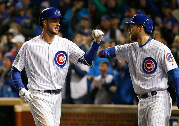 "<div class=""meta image-caption""><div class=""origin-logo origin-image none""><span>none</span></div><span class=""caption-text"">Chicago Cubs' Kris Bryant, left, celebrates with Ben Zobrist after hitting a home run during the fourth inning of Game 5. (AP Photo/Nam Y. Huh)</span></div>"