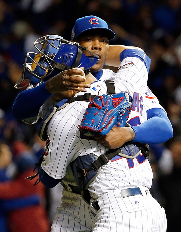 "<div class=""meta image-caption""><div class=""origin-logo origin-image none""><span>none</span></div><span class=""caption-text"">Chicago Cubs relief pitcher Aroldis Chapman and catcher Willson Contreras celebrate after Game 5. (AP Photo/Nam Y. Huh)</span></div>"