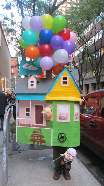 "<div class=""meta image-caption""><div class=""origin-logo origin-image none""><span>none</span></div><span class=""caption-text"">This contestant, among the finalists in the contest, is dressed as the house from ''Up,'' complete with characters from the movie.</span></div>"