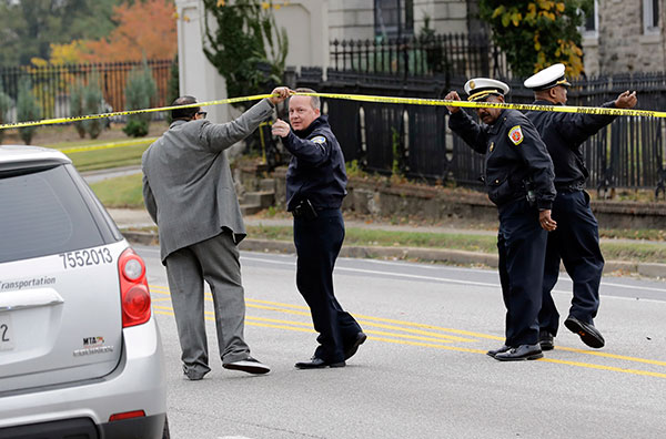 <div class='meta'><div class='origin-logo' data-origin='none'></div><span class='caption-text' data-credit='Patrick Semansky/AP Photo'>Baltimore Police Department commissioner Kevin Davis, second from left, approaches the scene of an early morning fatal collision between a school bus and a commuter bus.</span></div>