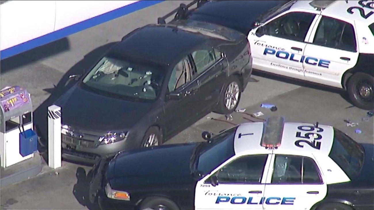 Torrance police cars block in a suspect's vehicle on Monday, Oct. 31, 2016.