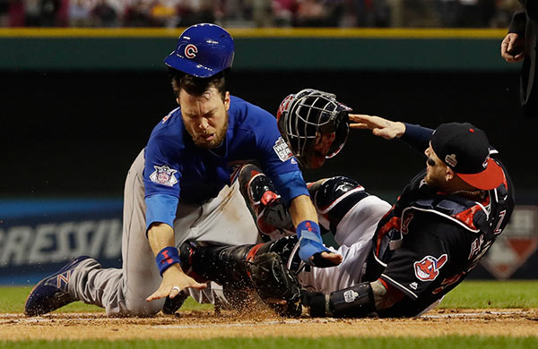 "<div class=""meta image-caption""><div class=""origin-logo origin-image ap""><span>AP</span></div><span class=""caption-text"">Chicago Cubs' Ben Zobrist collides with Cleveland Indians catcher Roberto Perez as he scores during the first inning of Game 6 of the Major League Baseball World Series. (AP Photo/David J. Phillip)</span></div>"