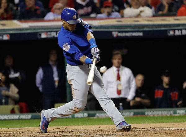 "<div class=""meta image-caption""><div class=""origin-logo origin-image ap""><span>AP</span></div><span class=""caption-text"">Chicago Cubs' Addison Russell hits a grand slam during the third inning of Game 6 of the Major League Baseball World Series against the Cleveland Indians Tuesday, Nov. 1, 2016. (AP Photo/David J. Phillip)</span></div>"