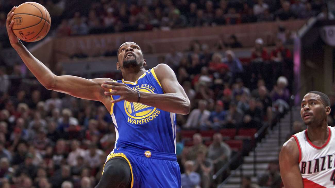 Golden State Warriors forward Kevin Durant, left, is fouled by Portland Trail Blazers forward Maurice Harkless, right, during an NBA basketball game in Portland, Ore., Nov 1, 2016.
