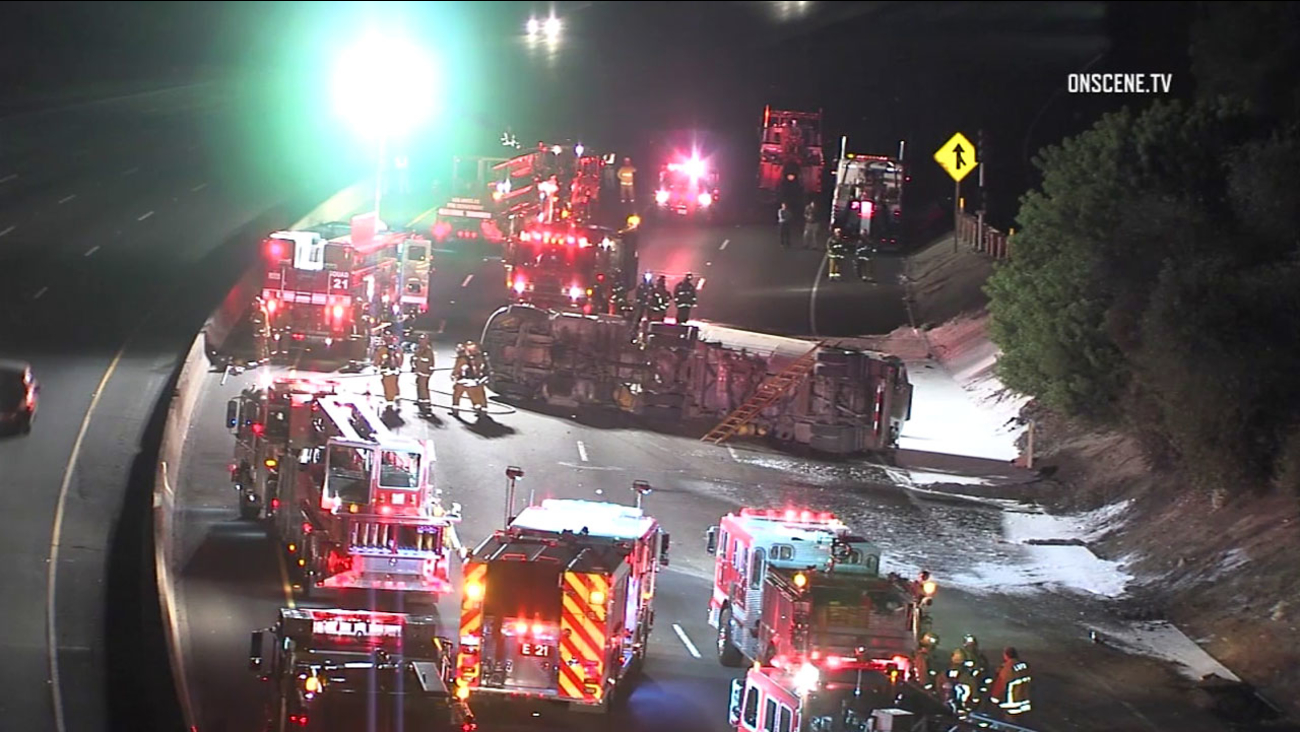 Los Angeles Fire Department crews worked to clear a fuel spill and move an overturned tanker on the northbound 5 Freeway near Atwater Village on Wednesday, Nov. 2, 2016.