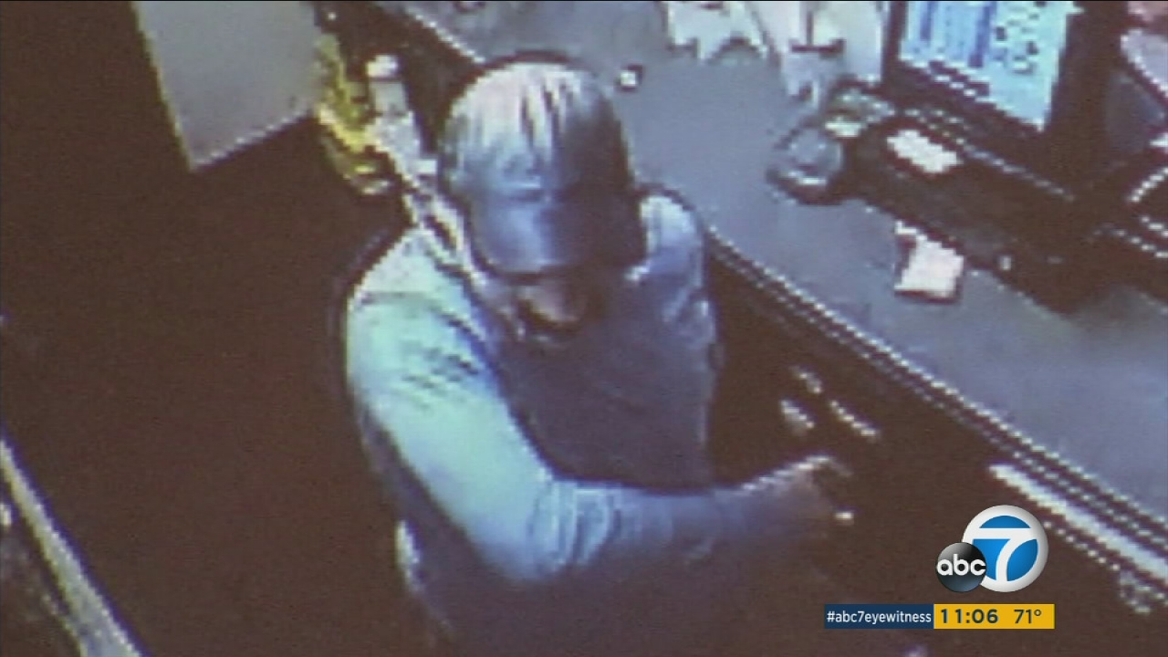 A masked suspect is shown on surveillance video from an El Monte Jack in the Box moments before he killed cashier Juan Vidal.