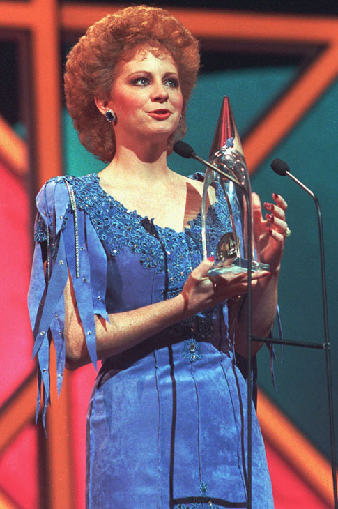 "<div class=""meta image-caption""><div class=""origin-logo origin-image none""><span>none</span></div><span class=""caption-text"">Reba McEntire accepts her Country Music Association Entertainer of the Year award in Nashville, Tenn., Oct. 13, 1986. (AP Photo)</span></div>"