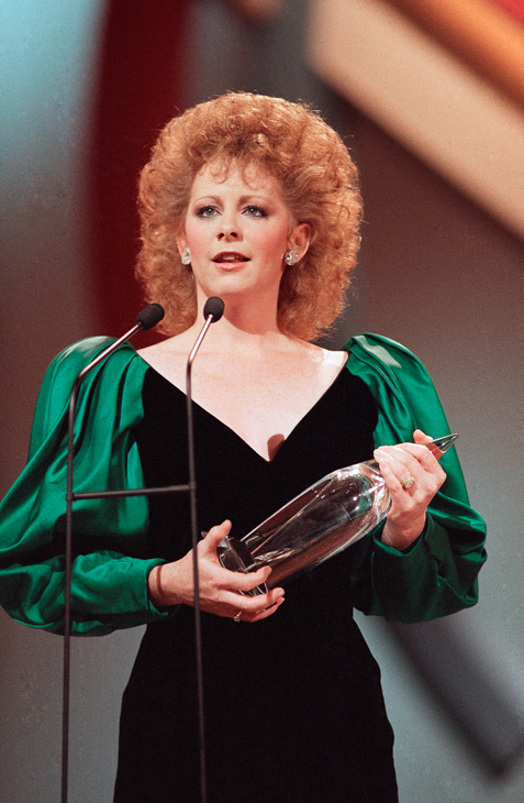 "<div class=""meta image-caption""><div class=""origin-logo origin-image none""><span>none</span></div><span class=""caption-text"">Reba McEntire accepts the female vocalist of the year award at the 21st annual Country Music Association awards show in Nashville on Monday Oct. 12, 1987. (Mark Humphrey/AP)</span></div>"