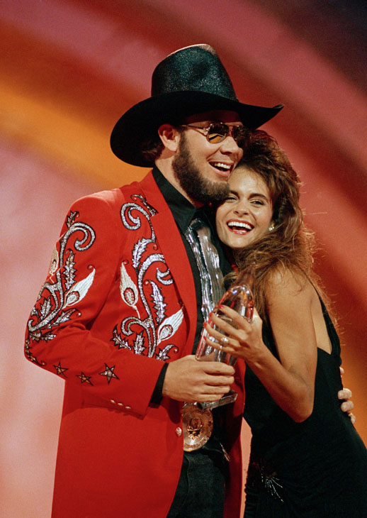 "<div class=""meta image-caption""><div class=""origin-logo origin-image none""><span>none</span></div><span class=""caption-text"">Hank Williams Jr. gets a hug from the awards presenter as he accepts his entertainer of the year award Oct. 10, 1988 at the CMA awards show in Nashville. (Mark Humphrey/AP Photo)</span></div>"