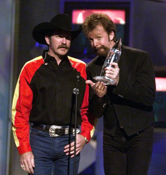 "<div class=""meta image-caption""><div class=""origin-logo origin-image none""><span>none</span></div><span class=""caption-text"">Brooks & Dunn accept the vocal duo of the year award at the Country Music Association Awards show in Nashville, Tenn., Wednesday, Sept. 22, 1999. (Michael S. Green/AP)</span></div>"