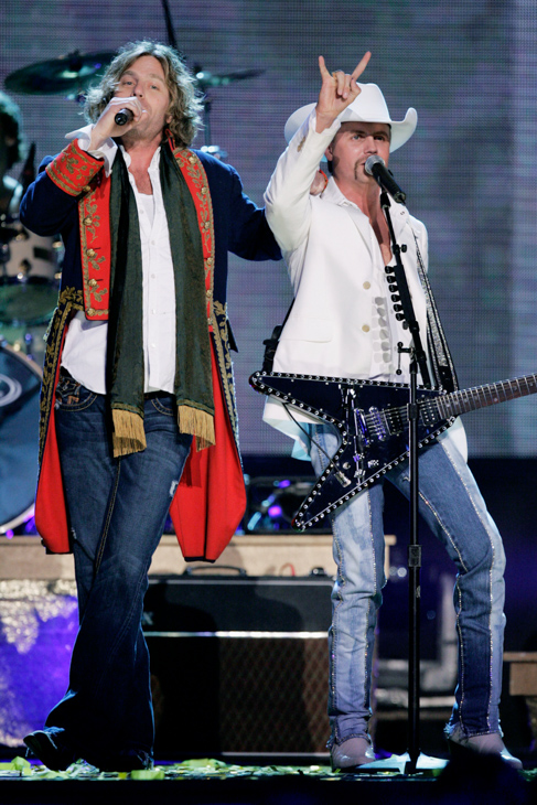 "<div class=""meta image-caption""><div class=""origin-logo origin-image none""><span>none</span></div><span class=""caption-text"">John Rich, right, and Big Kenny of the duo Big & Rich perform ""Comin' To Your City"" during the 39th Annual Country Music Association Awards Tuesday, Nov. 15, 2005, in New York. (Julie Jacobson/AP Photo)</span></div>"