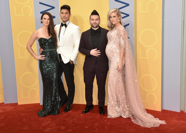 "<div class=""meta image-caption""><div class=""origin-logo origin-image none""><span>none</span></div><span class=""caption-text"">Abby Law, from left, Dan Smyers, Shay Mooney, of the musical group Dan + Shay, and Hannah Billingsley arrive at the 50th annual CMA Awards. (Evan Agostini/Invision/AP)</span></div>"