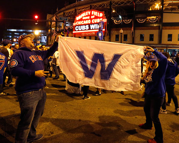 "<div class=""meta image-caption""><div class=""origin-logo origin-image none""><span>none</span></div><span class=""caption-text"">Chicago Cubs fans celebrate outside Wrigley Field in Chicago after the Cubs' 9-3 win over the Cleveland Indians in Game 6. (AP Photo/Charles Rex Arbogast)</span></div>"