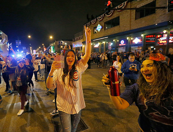 "<div class=""meta image-caption""><div class=""origin-logo origin-image none""><span>none</span></div><span class=""caption-text"">Chicago Cubs fans celebrate outside Wrigley Field in Chicago after the Cubs' 9-3 win over the Cleveland Indians in Cleveland in Game 6. (AP Photo/Charles Rex Arbogast)</span></div>"