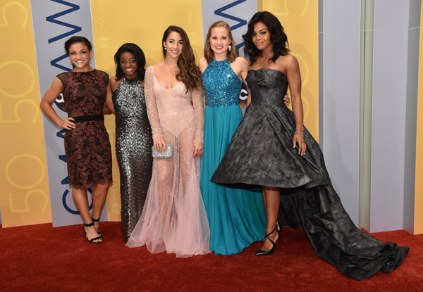 "<div class=""meta image-caption""><div class=""origin-logo origin-image none""><span>none</span></div><span class=""caption-text"">Olympic gymnasts Laurie Hernandez, from left, Simone Biles, Aly Raisman, Madison Kocian, and Gabby Douglas arrive at the 50th annual CMA Awards. (Evan Agostini/Invision/AP)</span></div>"