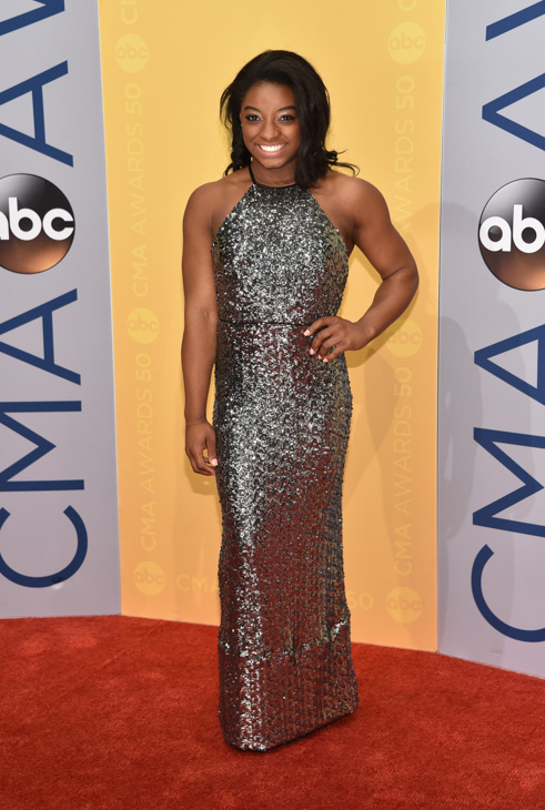 "<div class=""meta image-caption""><div class=""origin-logo origin-image none""><span>none</span></div><span class=""caption-text"">Simone Biles arrives at the 50th annual CMA Awards at the Bridgestone Arena on Wednesday, Nov. 2, 2016, in Nashville, Tenn. (Evan Agostini/Invision/AP)</span></div>"