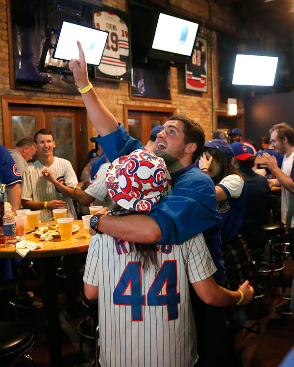 "<div class=""meta image-caption""><div class=""origin-logo origin-image none""><span>none</span></div><span class=""caption-text"">Chicago Cubs fans celebrate at the Cubby Bear bar across the street from Wrigley Field after Javier Baez's fifth-inning home run against the Cleveland Indians during Game 7. (AP Photo/Charles Rex Arbogast)</span></div>"