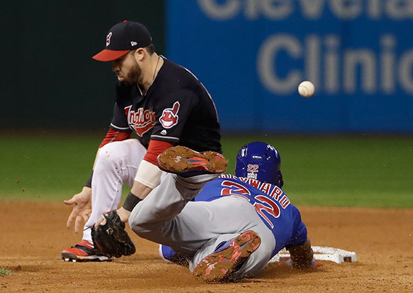 "<div class=""meta image-caption""><div class=""origin-logo origin-image none""><span>none</span></div><span class=""caption-text"">Cleveland Indians' Jason Kipnis can't handle the throw as Chicago Cubs' Jason Heyward steals second and advances to third on the throw during the ninth inning of Game 7. (AP Photo/David J. Phillip)</span></div>"