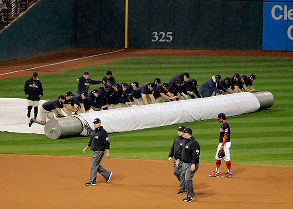 "<div class=""meta image-caption""><div class=""origin-logo origin-image none""><span>none</span></div><span class=""caption-text"">Workers cover the infield at Progressive Field during the 10th inning of Game 7. (AP Photo/Gene J. Puskar)</span></div>"