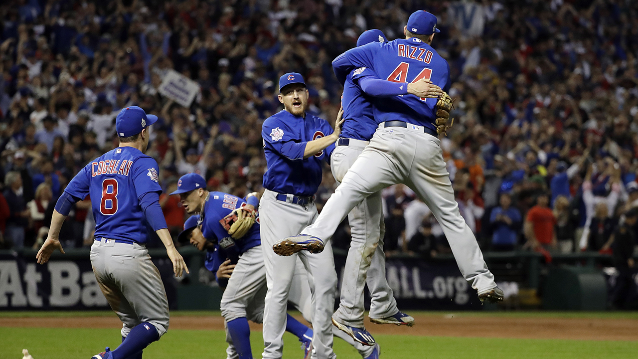 Chicago Cubs players celebrate a long awaited baseball championship after the end of Game 7 in Cleveland.
