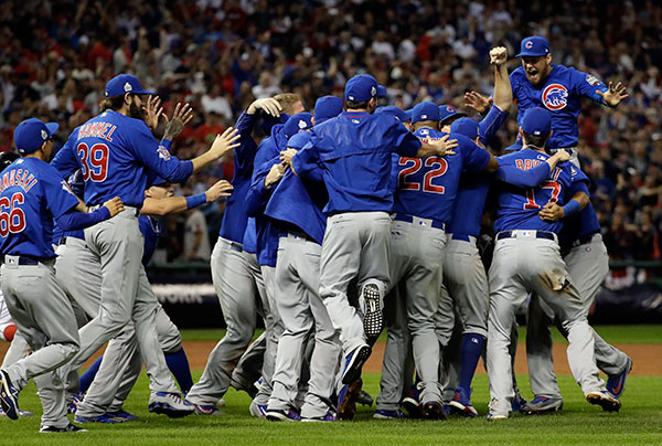 "<div class=""meta image-caption""><div class=""origin-logo origin-image none""><span>none</span></div><span class=""caption-text"">The Chicago Cubs celebrate after Game 7 of the Major League Baseball World Series. (AP Photo/David J. Phillip)</span></div>"