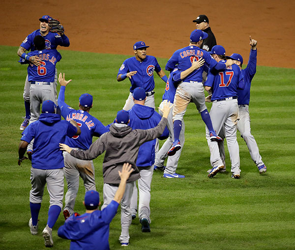 "<div class=""meta image-caption""><div class=""origin-logo origin-image none""><span>none</span></div><span class=""caption-text"">The Chicago Cubs celebrate after Game 7 of the Major League Baseball World Series. The Cubs won 8-7 in 10 innings to win the series 4-3. (AP Photo/Gene J. Puskar)</span></div>"