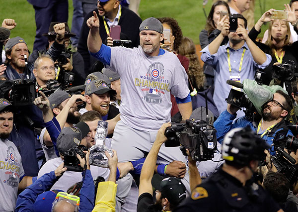 "<div class=""meta image-caption""><div class=""origin-logo origin-image none""><span>none</span></div><span class=""caption-text"">Chicago Cubs' David Ross is carried by teammates after Game 7 of the Major League Baseball World Series. The Cubs won 8-7 in 10 innings to win the series 4-3. (AP Photo/Gene J. Puskar)</span></div>"