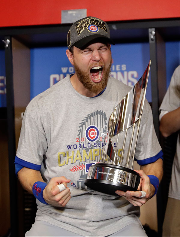 "<div class=""meta image-caption""><div class=""origin-logo origin-image none""><span>none</span></div><span class=""caption-text"">Chicago Cubs' Ben Zobrist celebrates with his MVP trophy after Game 7. (AP Photo/David J. Phillip)</span></div>"