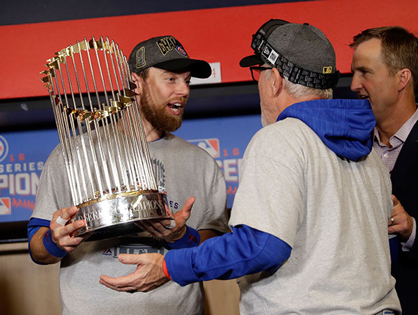 "<div class=""meta image-caption""><div class=""origin-logo origin-image none""><span>none</span></div><span class=""caption-text"">Chicago Cubs' Ben Zobrist and manager Joe Maddon celebrate after Game 7. (AP Photo/David J. Phillip)</span></div>"