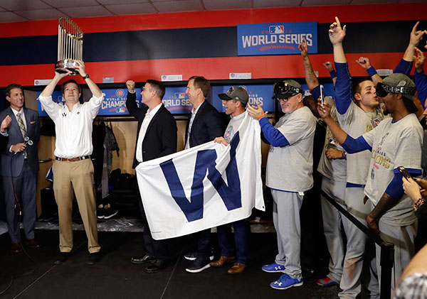 "<div class=""meta image-caption""><div class=""origin-logo origin-image none""><span>none</span></div><span class=""caption-text"">Chicago Cubs Chairman Tom Ricketts holds up the trophy as he celebrates with the team after Game 7. (AP Photo/David J. Phillip)</span></div>"