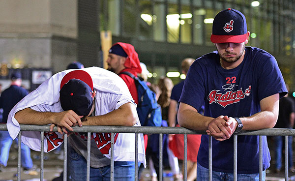 "<div class=""meta image-caption""><div class=""origin-logo origin-image none""><span>none</span></div><span class=""caption-text"">Cleveland Indians fans Levi Jones, left, and Kyle Zabarsky react during a watch party, after Game 7. (AP Photo/David Dermer)</span></div>"