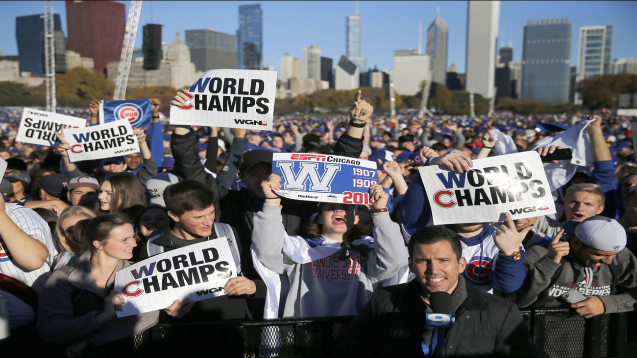 Chicago Cubs fans celebrate before a rally in Grant Park honoring the World Series baseball champions Friday, Nov. 4, 2016, in Chicago.