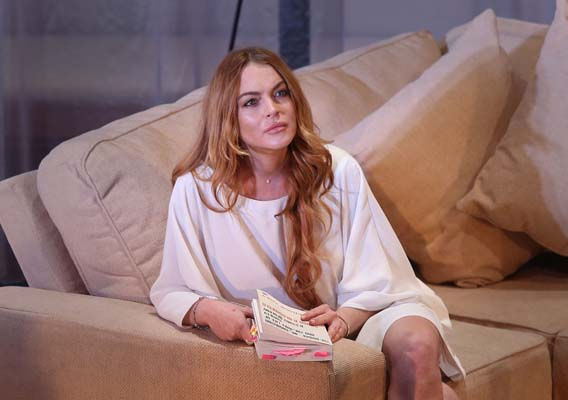 <div class='meta'><div class='origin-logo' data-origin='none'></div><span class='caption-text' data-credit='AP'>U.S actress Lindsay Lohan (Photo by Joel Ryan/Invision/AP, File)</span></div>