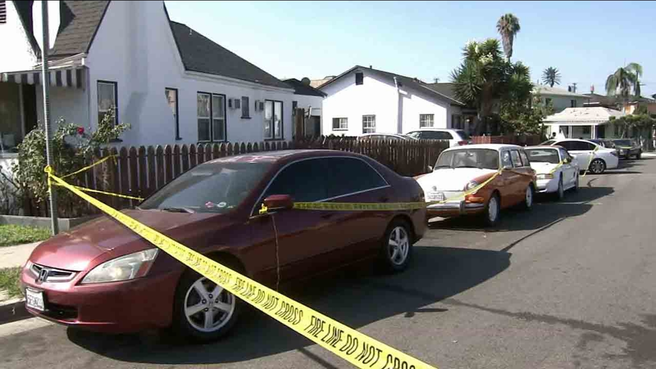 Los Angeles County sheriff's deputies respond to the scene of a fatal shooting in the 1400 block of South Woods Place in East Los Angeles Saturday, July 5, 2014.