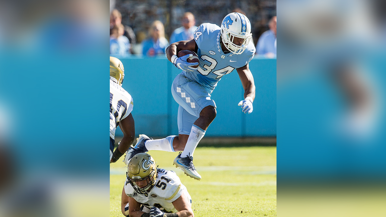 North Carolina's Elijah Hood (34) jumps over Georgia Tech's Brant Mitchell (51) during the first half of an NCAA college football game Chapel Hill, N.C., Saturday, Nov. 5, 2016.