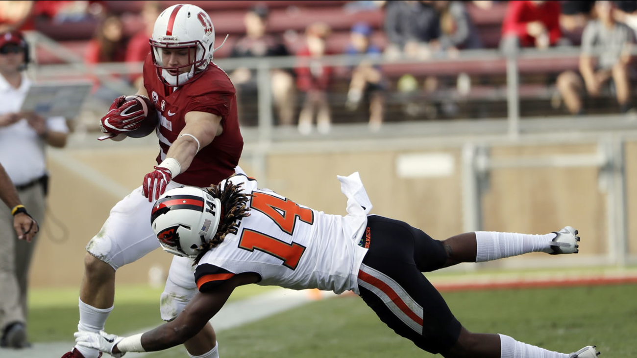 Stanford running back Christian McCaffrey (5) is tackled by Oregon State cornerback Treston Decoud (14) during the second half a football game Saturday, Nov. 5, 2016.
