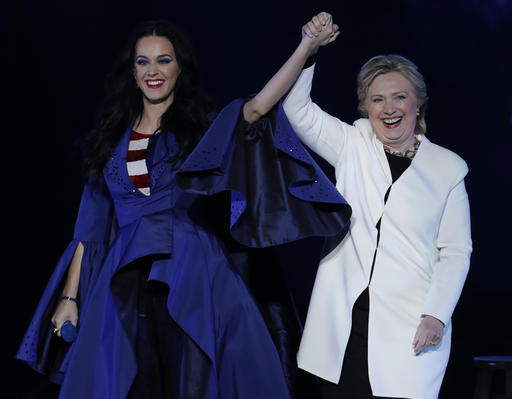 <div class='meta'><div class='origin-logo' data-origin='AP'></div><span class='caption-text' data-credit='AP'>Katy Perry, left, holds the hand of Democratic presidential candidate, Hillary Clinton, right, during a concert at the Mann Center for the Performing Arts,</span></div>