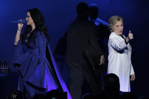 "<div class=""meta image-caption""><div class=""origin-logo origin-image ap""><span>AP</span></div><span class=""caption-text"">Katy Perry, left, addresses the crowd during a concert supporting Democratic presidential candidate, Hillary Clinton, right, at the Mann Center for the Performing Arts. (AP)</span></div>"