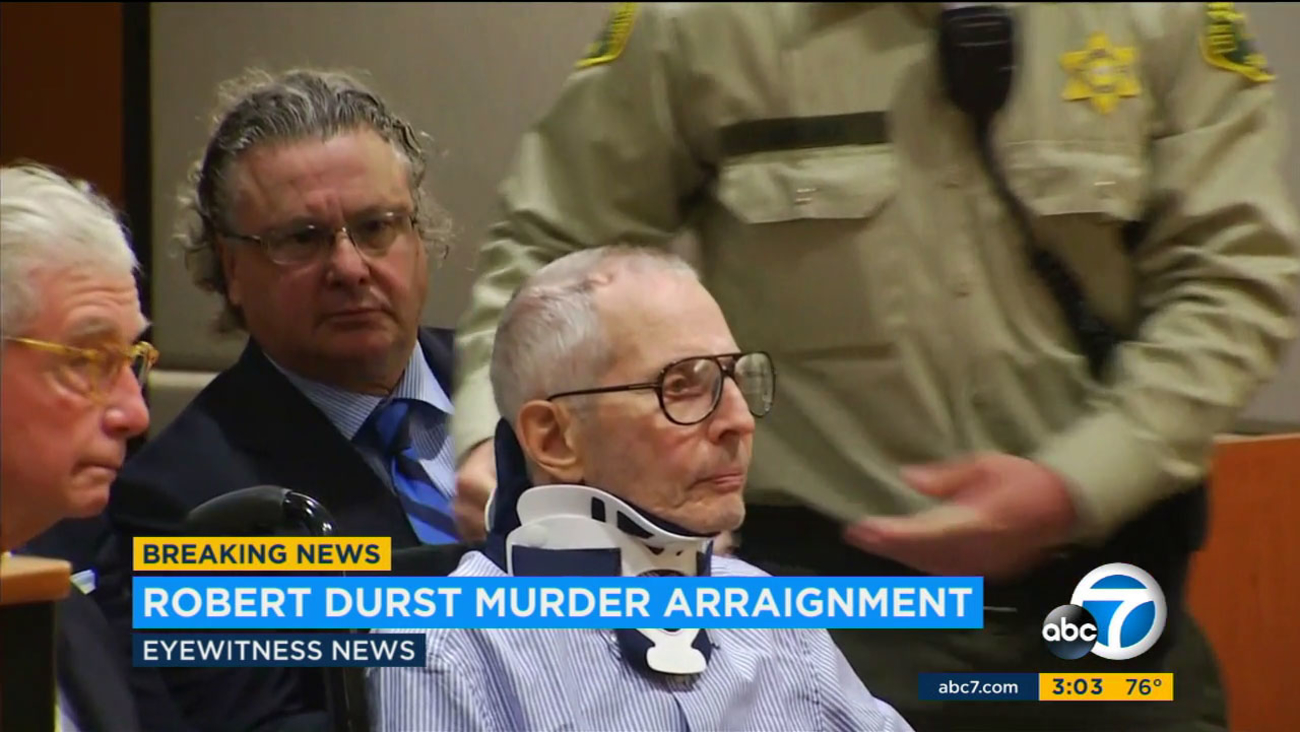 Appearing in a Los Angeles courtroom in a wheelchair and neck brace, real estate tycoon Robert Durst entered a not guilty plea to charges he murdered a friend in 2000.