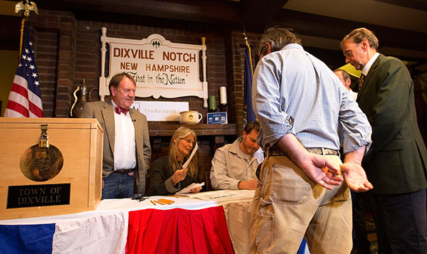 "<div class=""meta image-caption""><div class=""origin-logo origin-image none""><span>none</span></div><span class=""caption-text"">Voters in Dixville Notch, N.H., get their ballots Tuesday, Nov. 8, 2016, in Dixville Notch, N.H. The residents in town voted just after midnight. (Jim Cole/AP Photo)</span></div>"