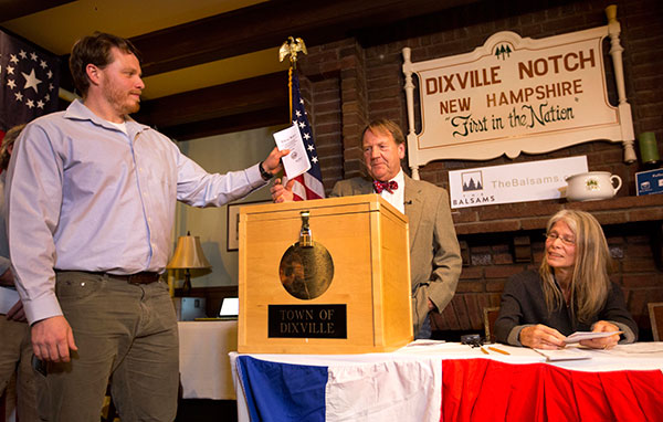 "<div class=""meta image-caption""><div class=""origin-logo origin-image none""><span>none</span></div><span class=""caption-text"">Dixville Notch's first voter Clay Smith drops his ballot into the box as moderator Tom Tillotson watches Tuesday, Nov. 8, 2016, in Dixville Notch, N.H. (Jim Cole/AP Photo)</span></div>"