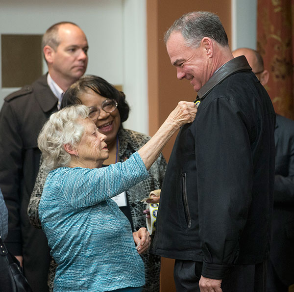 "<div class=""meta image-caption""><div class=""origin-logo origin-image none""><span>none</span></div><span class=""caption-text"">Minerva Trupin places an I Voted sticker on the jacket of Democratic vice presidential candidate US Sen. Tim Kaine, D-Va., after he voted in Richmond, Va., Tuesday, Nov. 8, 2016. (Steve Helber/AP Photo)</span></div>"