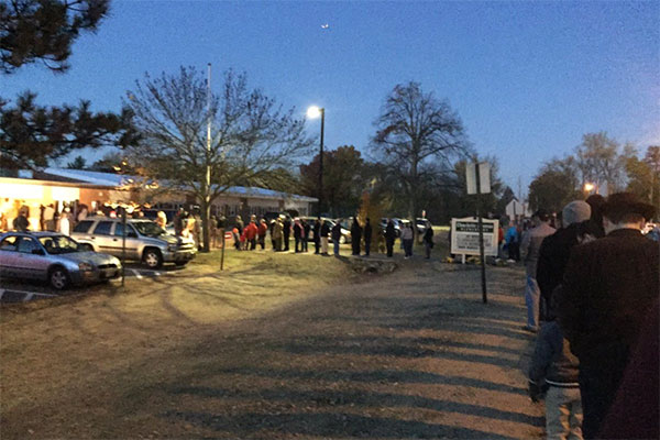 "<div class=""meta image-caption""><div class=""origin-logo origin-image none""><span>none</span></div><span class=""caption-text"">A voter estimated that five minutes before the polls opened in Nashua, N.H., about 200-300 people were lined up ''out the door, down the street in 2 directions.'' (daponovich/Twitter)</span></div>"